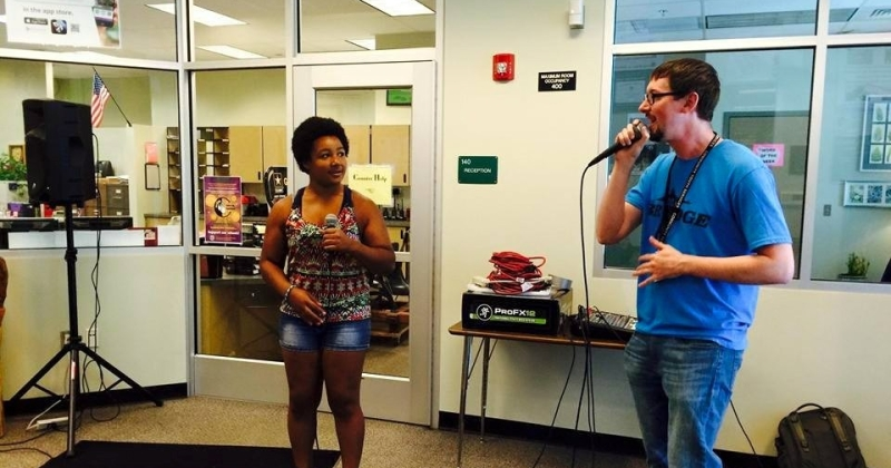 Jubilation Fellow Bobby Williams rapping with a student